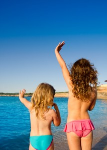 Ibiza Cala Conta little girls greeting hand sign